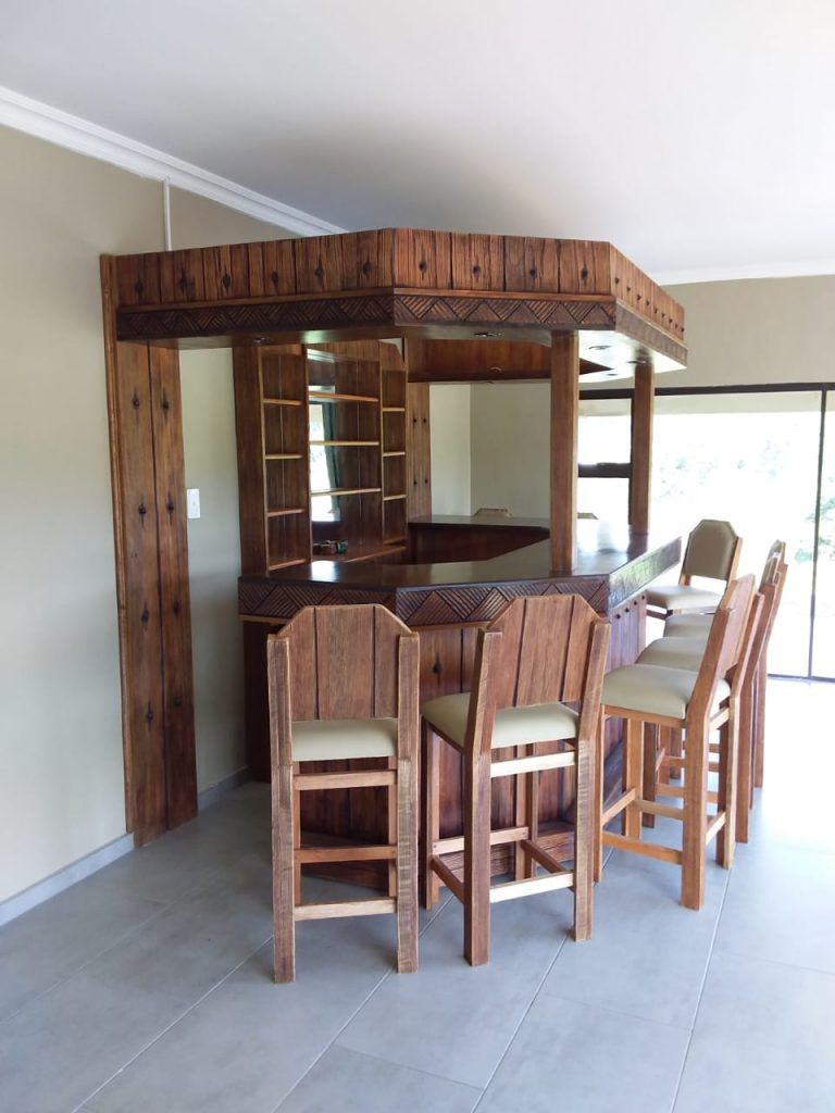 Bar.Sleeper design with carved cgairs 1 - Africarve Hand Crafted Doors and Church Furnishings